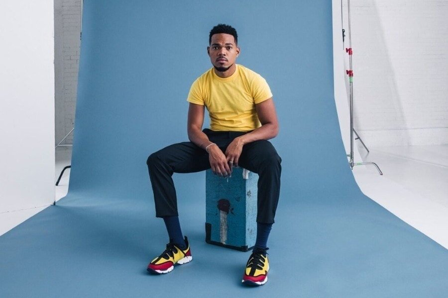 Chance the Rapper sitting on box in photo studio