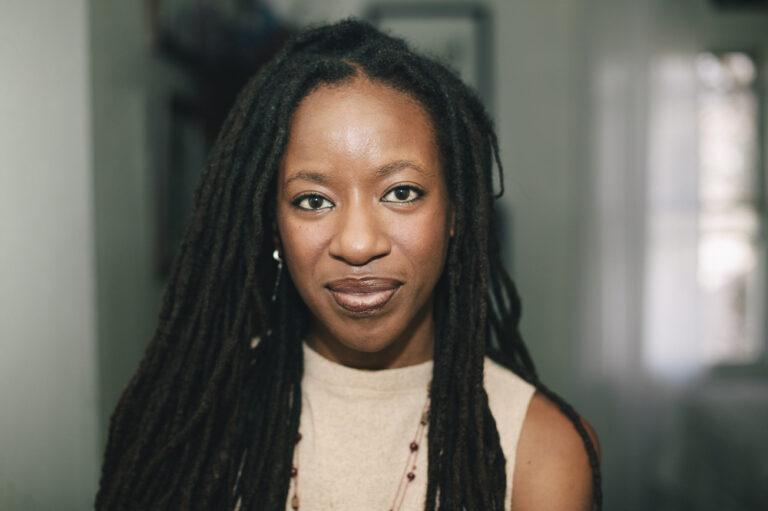 Black woman staring straight at camera