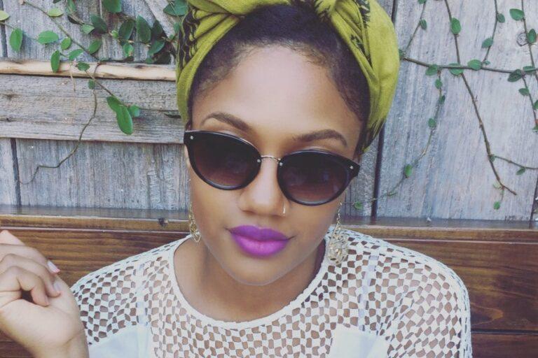 Black woman wearing sunglasses