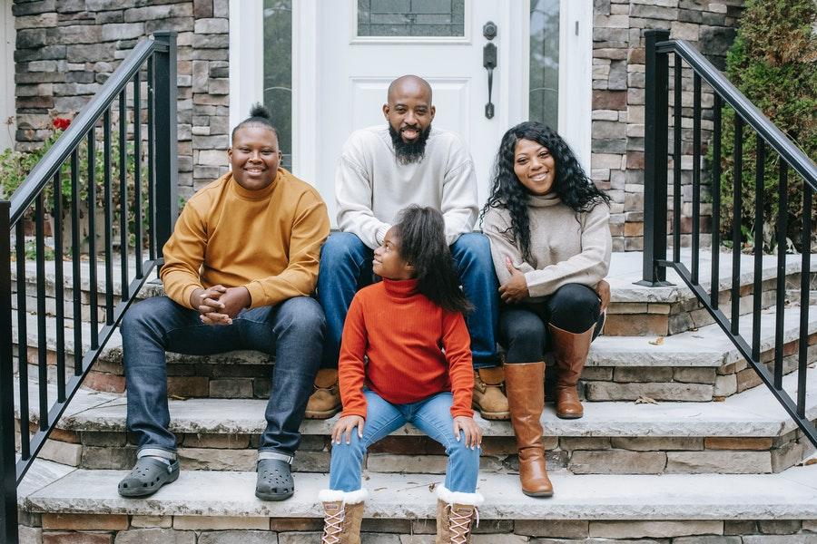 black family sitting on front steps